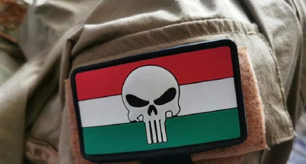A szerveződő magyar magán katonai magánvállalat tagjainak bedzse (badge - a zubbonyon, a bal felső karonviselt jelzés a hovatartozásról)
